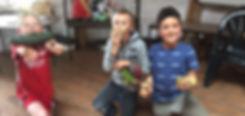 Children hlding vegetables