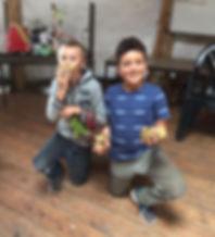 children growing vegetables