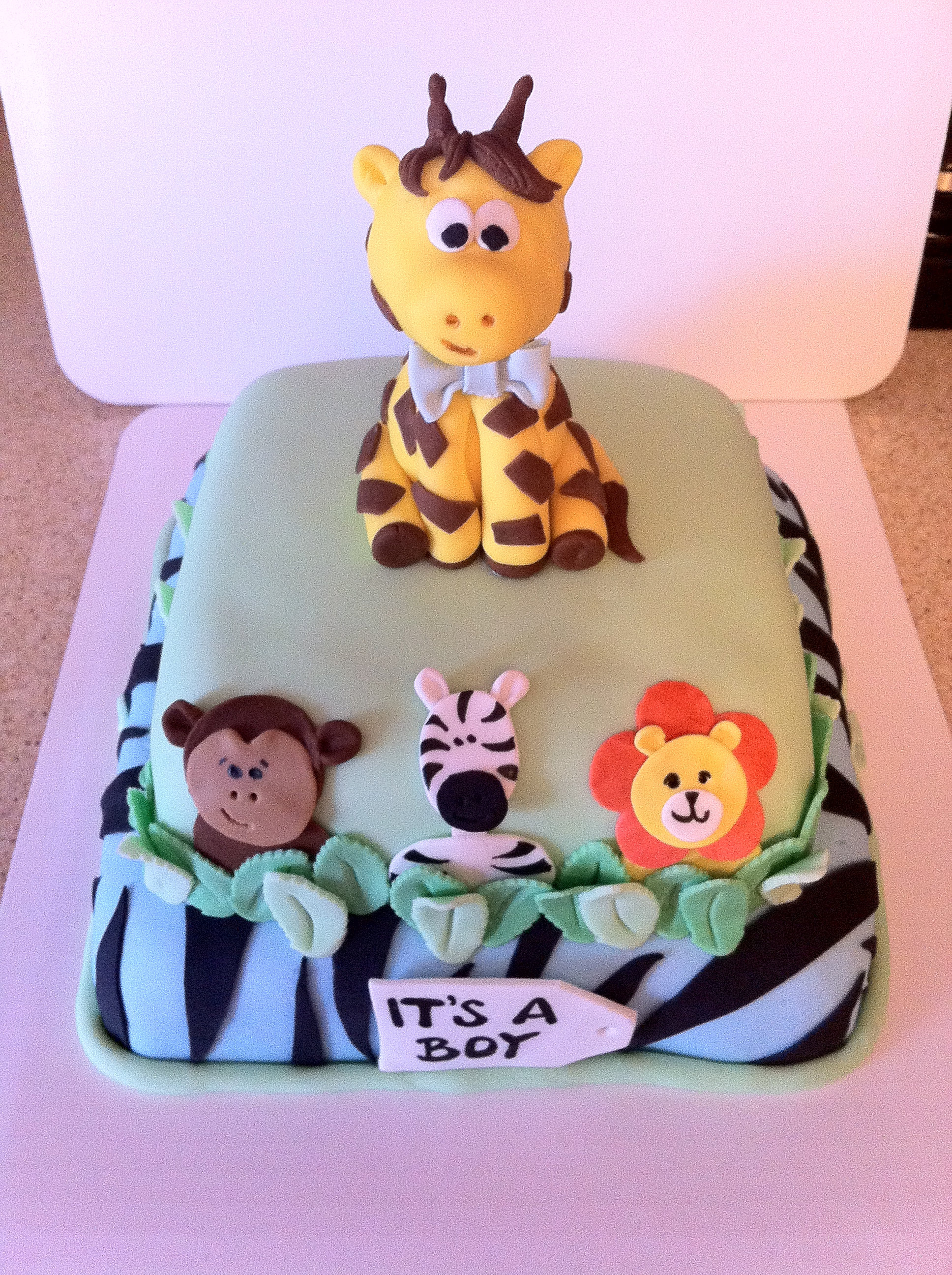 For one wild baby shower! Two-tier, fondant covered cake with fondant ...