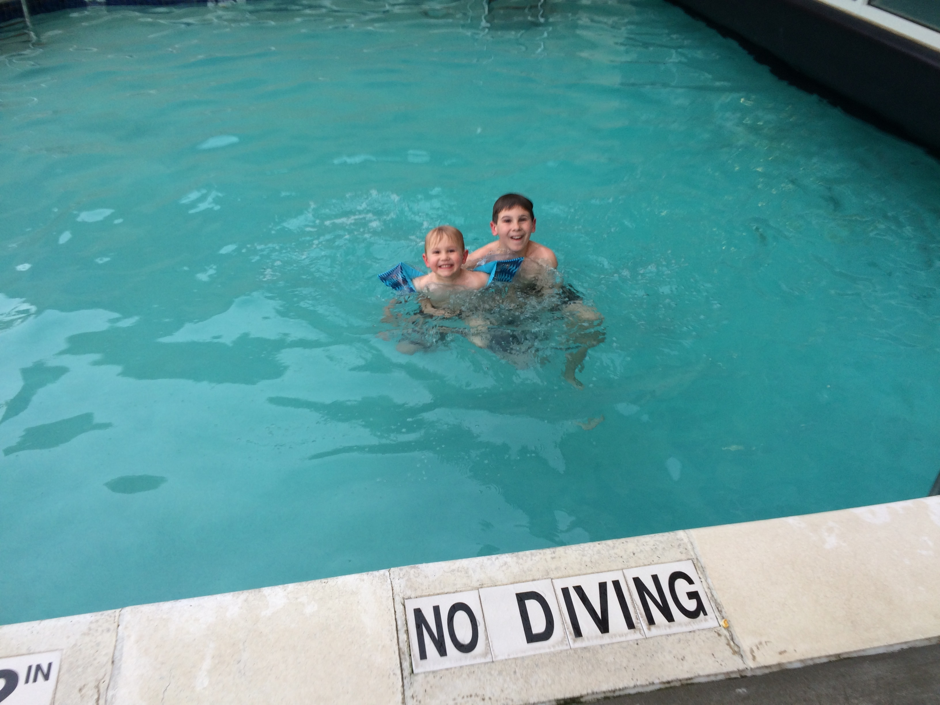 2 boys in hotel swimming pool