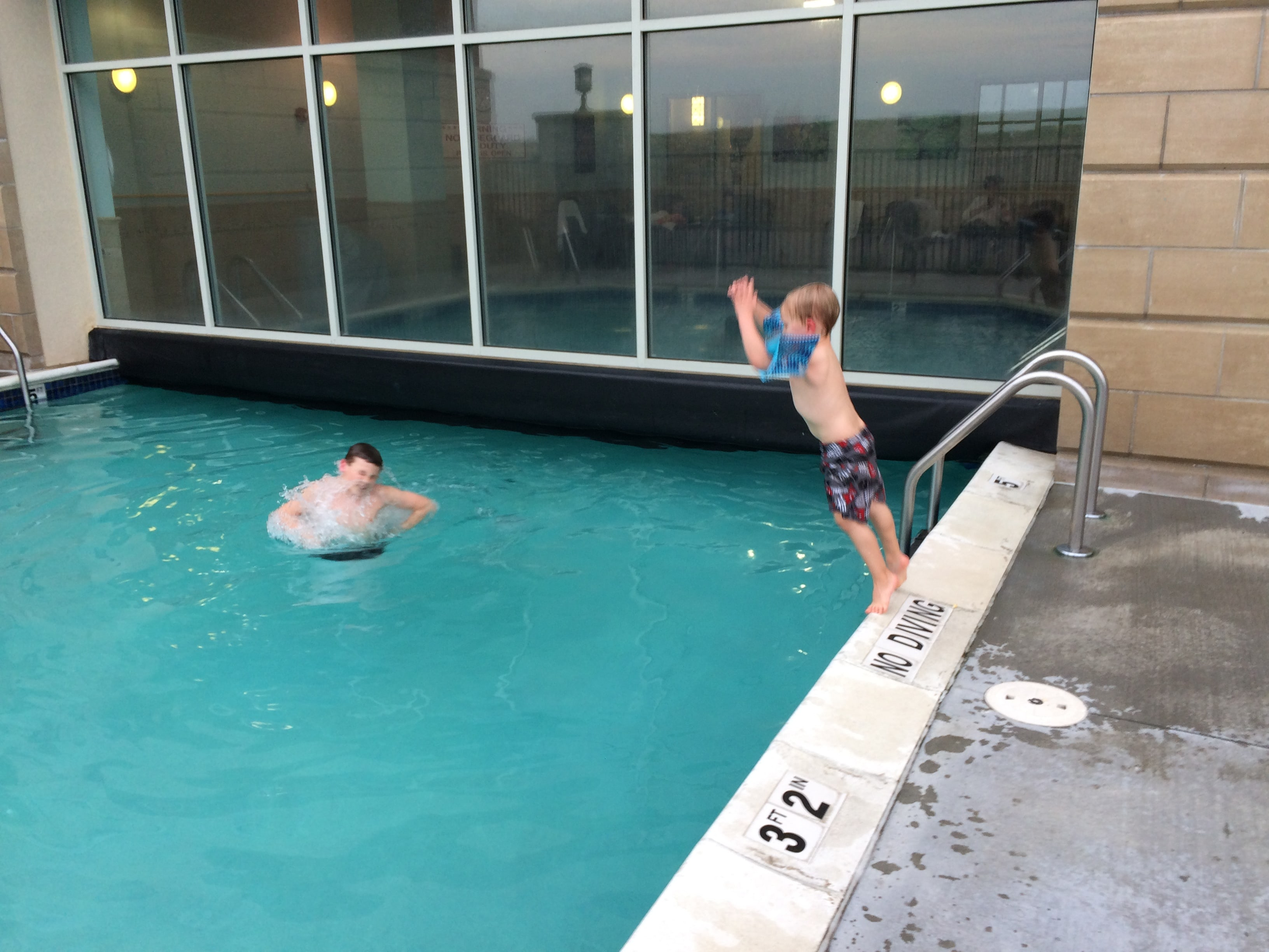 2 boys in Drury hotel swimming pool