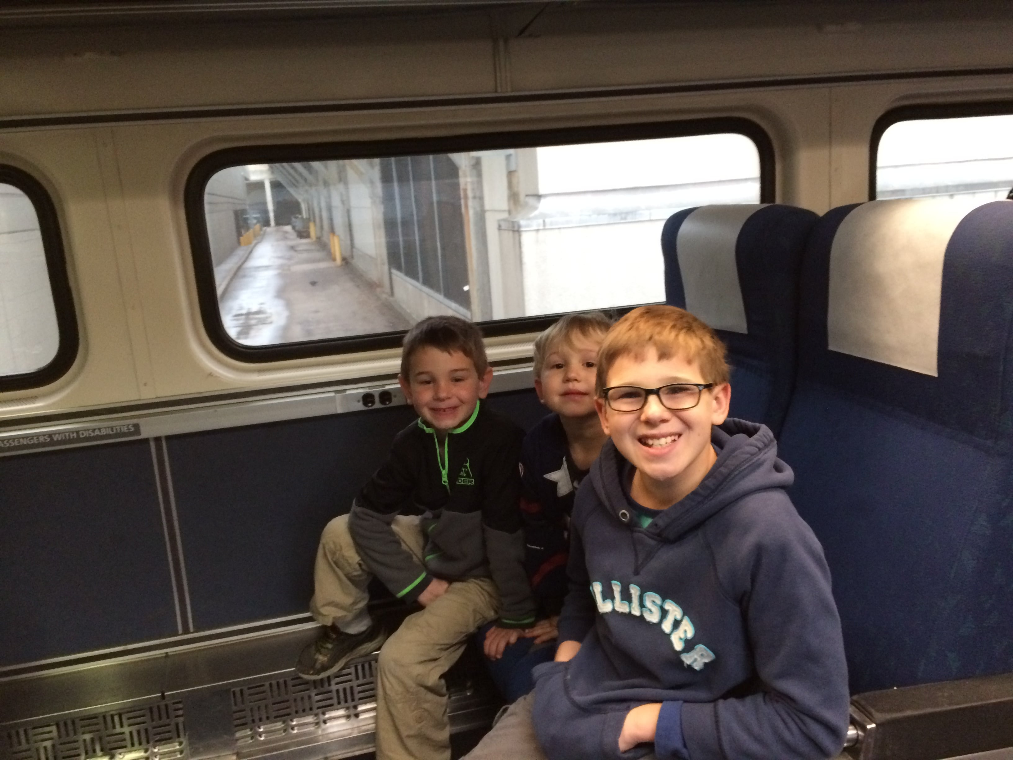 3 boys on Amtrak train