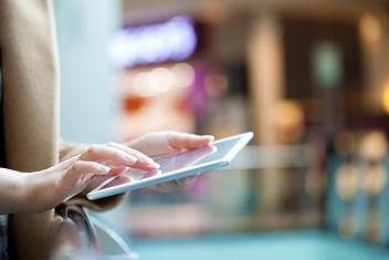 On-tablet-in-mall-403249.jpg