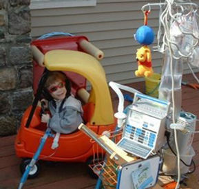 child on permanent ventilator playing outside