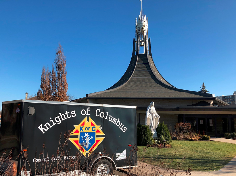 Front view of Holy Rosary Parish and the Knights Of Columbus trailer with the logo