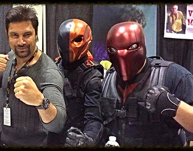 Manu Bennett posing with our Deathstroke and Red Hood helmets