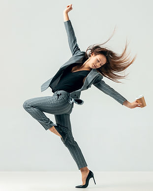 Happy business woman dancing and smiling in motion isolated over white studio background.