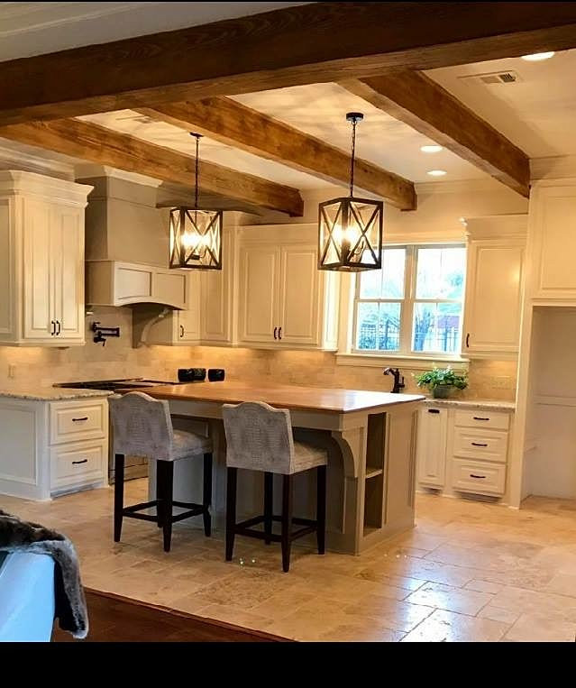 kitchen showing rustic beams over island - Madden Home Designs
