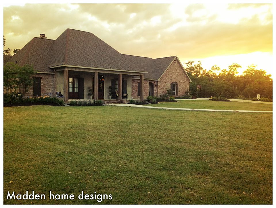 street view of rustic front option with wood posts and gable garage - Madden Home Designs