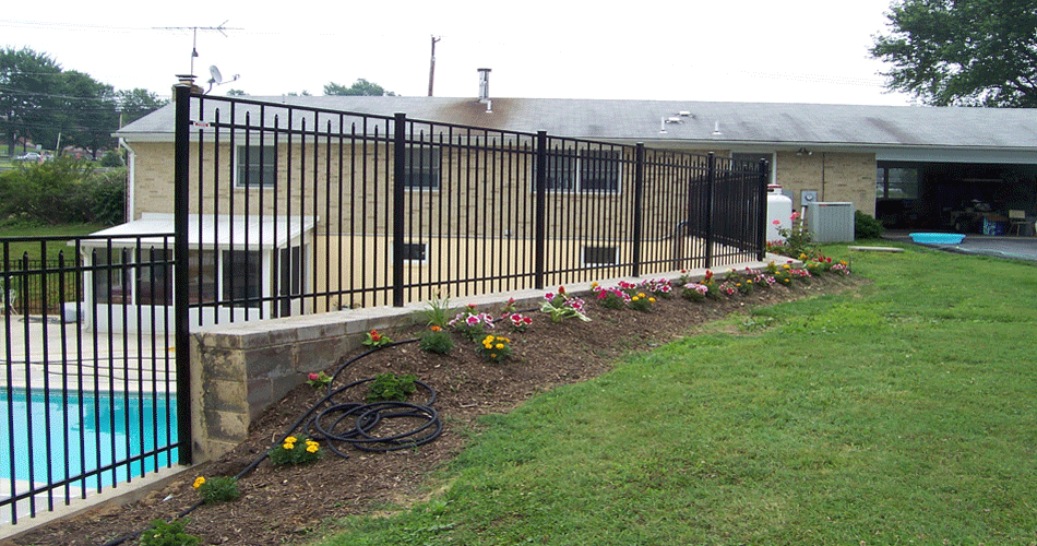 how to fix a fence on top of a wall