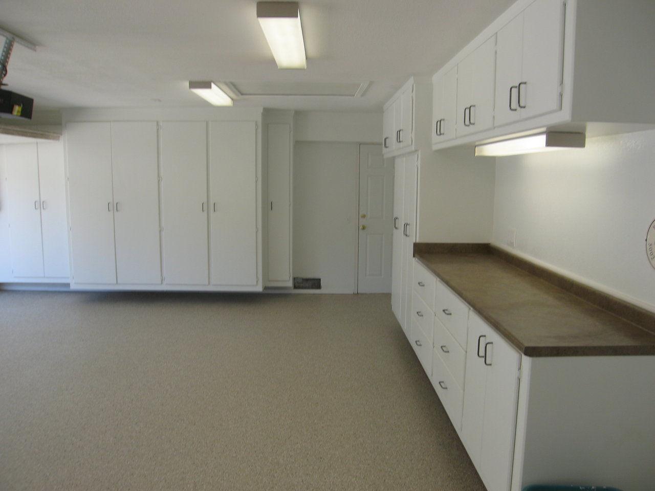 Floor To Ceiling Garage Cabinets Garage Cabinets And Epoxy Floor Coatings California Garage