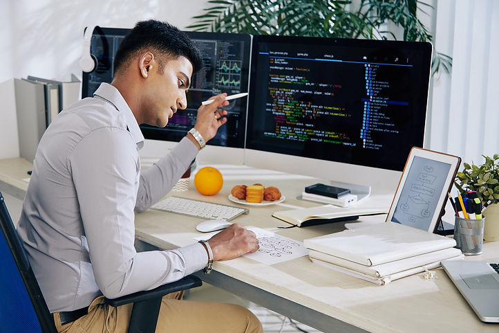 pensive-indian-developer-checking-structure-chart-when-working-programming-code-his-desl.j