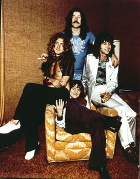 Led Zeppelin at the Riot House, Hollywood: Jimmy Page in white Malcolm Hall suit.