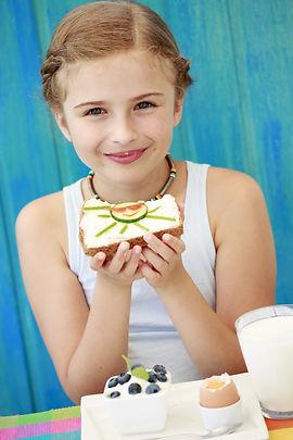 Summer breakfast - cute girl eating heal