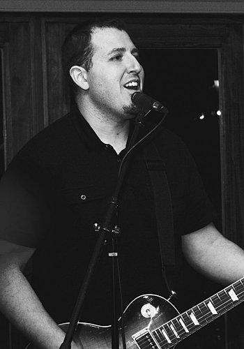 Dennis Sarakinis: guitar and vocals