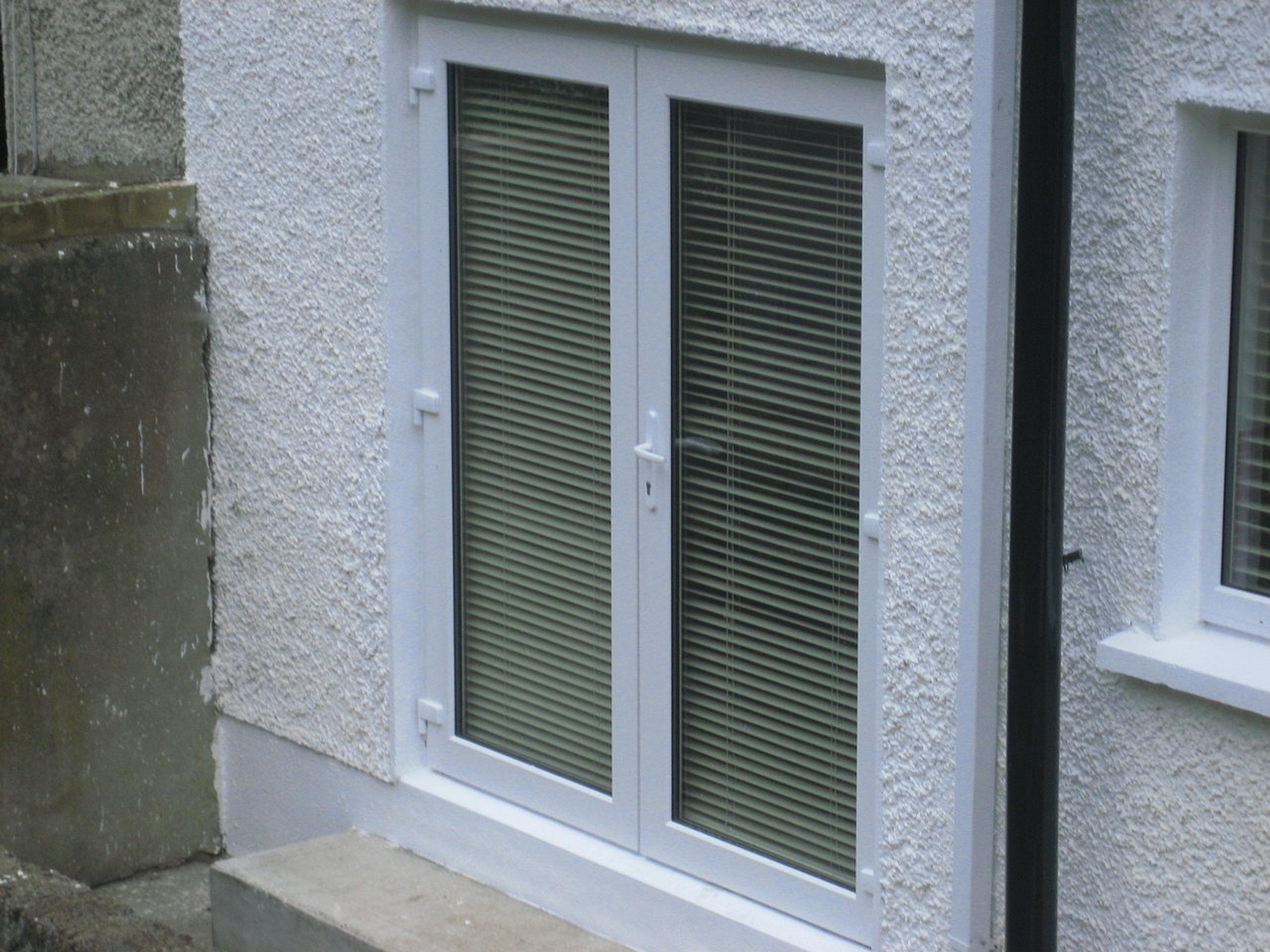 Coastal upvc windows dublin i upvc doors dublin white for Locks for french doors that open out