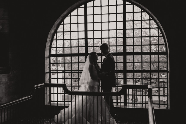 Bride and groom portrait in front of window, St. Augustine wedding planner