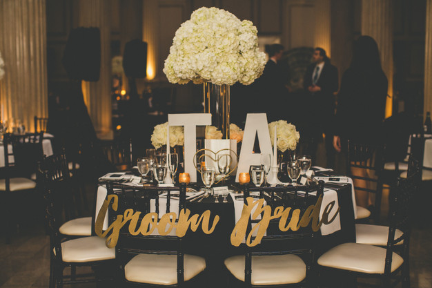 Black and gold bride and groom table, wedding reception at Treasury on the Plaza, St. Augustine wedding planner