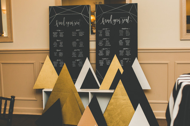 Black and gold wedding seating chart, wedding reception at Treasury on the Plaza, St. Augustine wedding planner