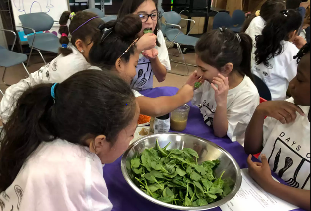 students tasting their salad dressing