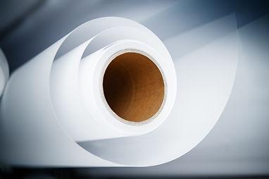Topshot macro Paper roll in a printshop.