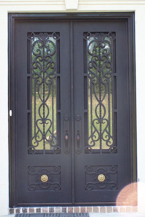 Taller metal mecanica soluciones arboleda for Puertas hierro forjado