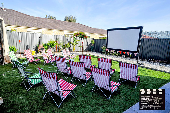 Backyard Movie Night Ideas candy for my outdoor movie party found rack at my local antique store Party Ideasoutdoor Movie Night Rentals 10 Deck Chairs Included