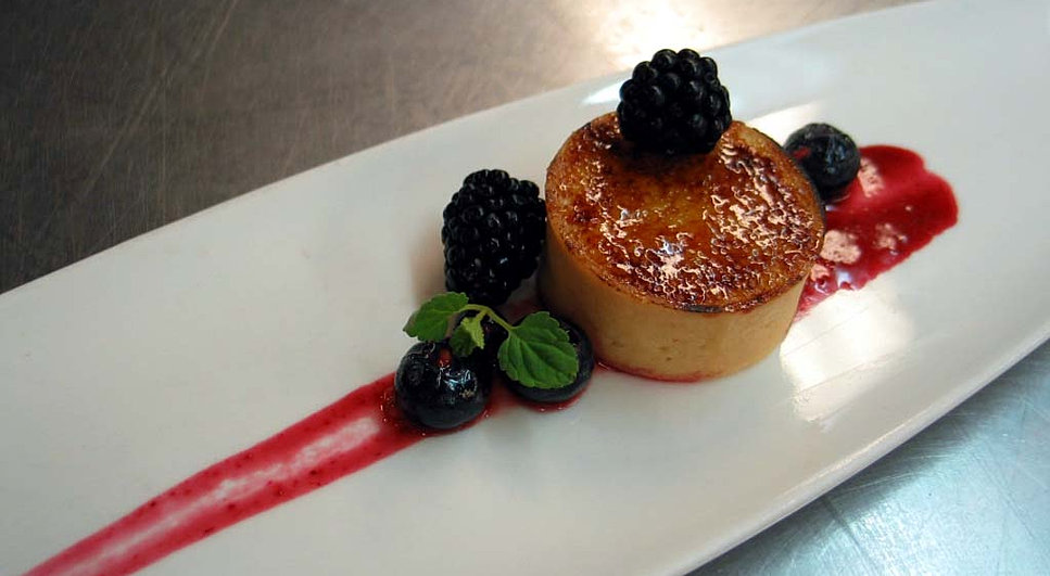... filled tartlet with blackberry coulis, fresh berries and mint