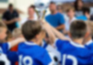 71531377-young-soccer-players-holding-tr