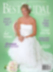 A bride sitting with her boquet of flowers next to her on the floor with airbrush makeup on the cover of St. Louis' Best Bridal Magazine