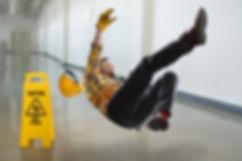 Worker falling on wet floor inside build