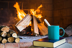 beverage-and-book-near-fireplace.jpg