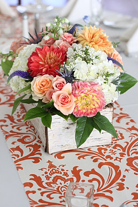 Orange and peach wedding centerpiece