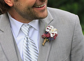 Navy and burgundy boutonniere
