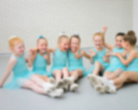 Group of cute little ballet dancers havi
