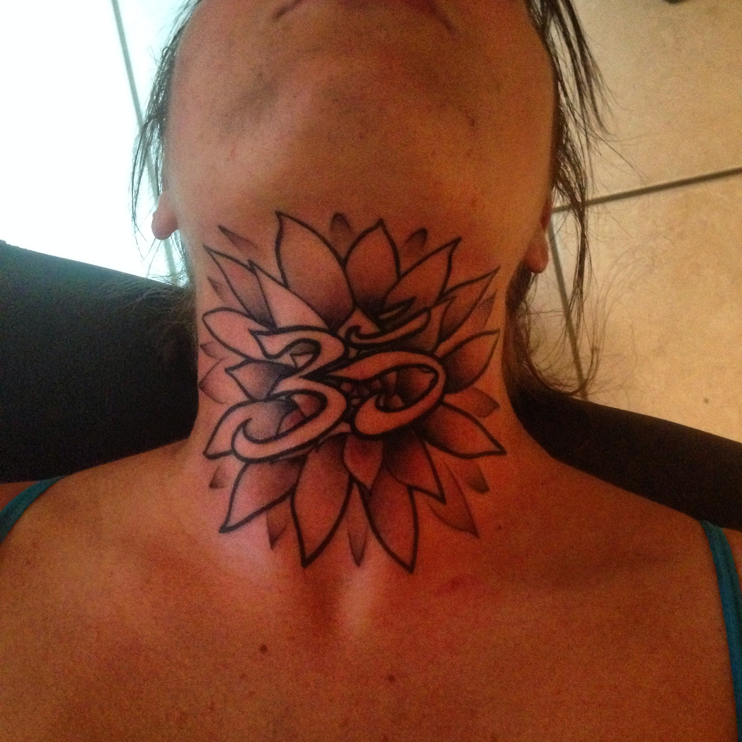Severe Ink | Ohm Flower Neck Tattoo
