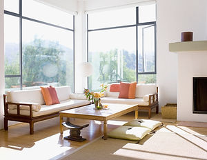 A sunny living room with large windows
