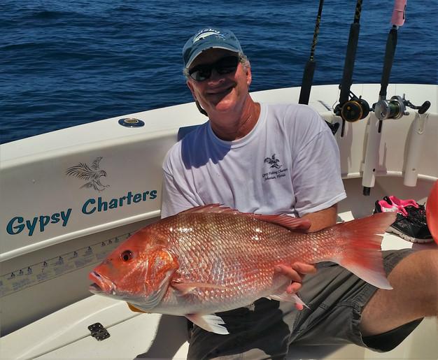 Captain catches a fish sebastian gypsy fishing charters for Sebastian fishing charters