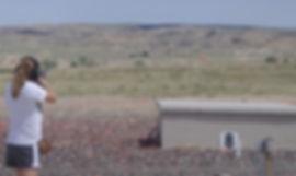 Girl shooting trap