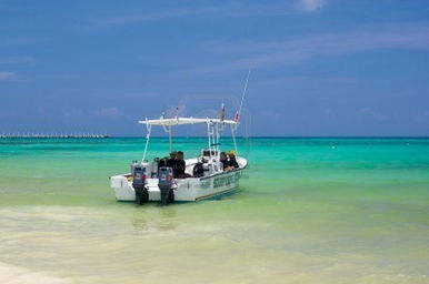 9887809-fishing-boat-near-cancun-mexico.jpg