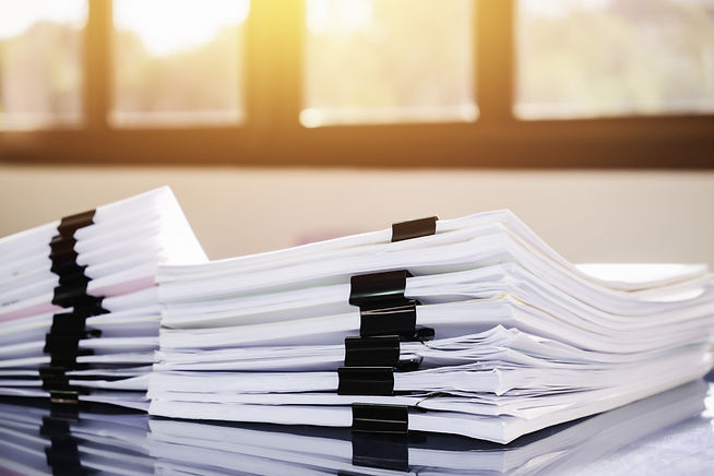 Paper stack on the desk related to busin