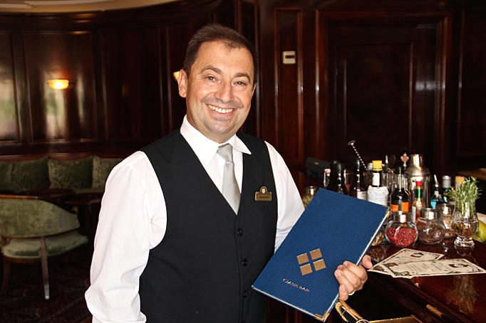 Joaquim Veras poses with bar's menu. It's not a compact list, but rather a lifestyle book. Several pages include more than three hundred references, from ports and liqueurs, national and imported gins, whiskeys, champagnes, classic cocktails, innovative cocktails, coffees and teas. Within this menu-book you will find proposals for any time of the day.