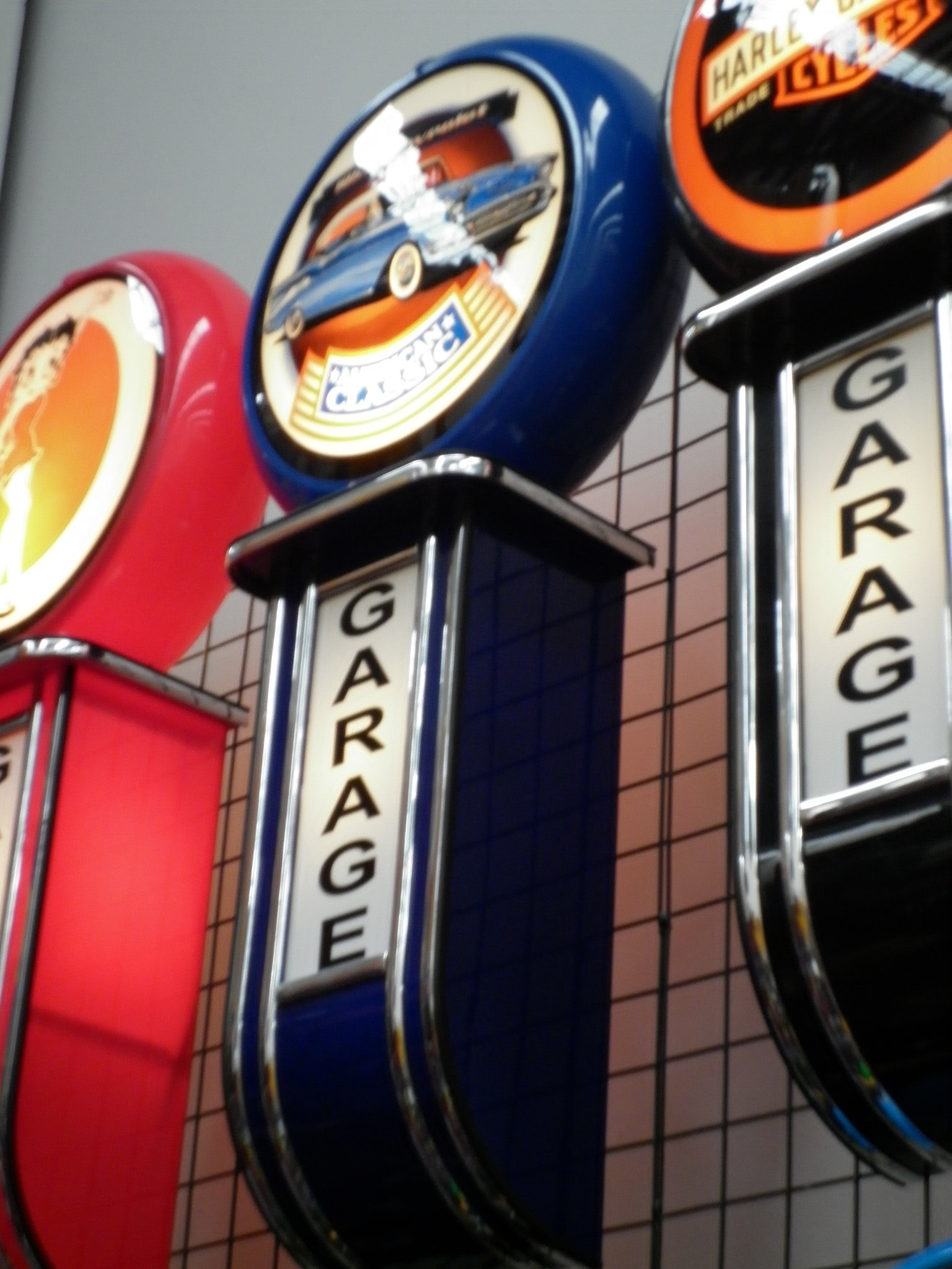 Pinball machines arcade games bar stools garage signs for American classics garage
