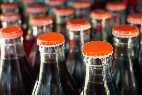 soft drinks in bottles background.jpg