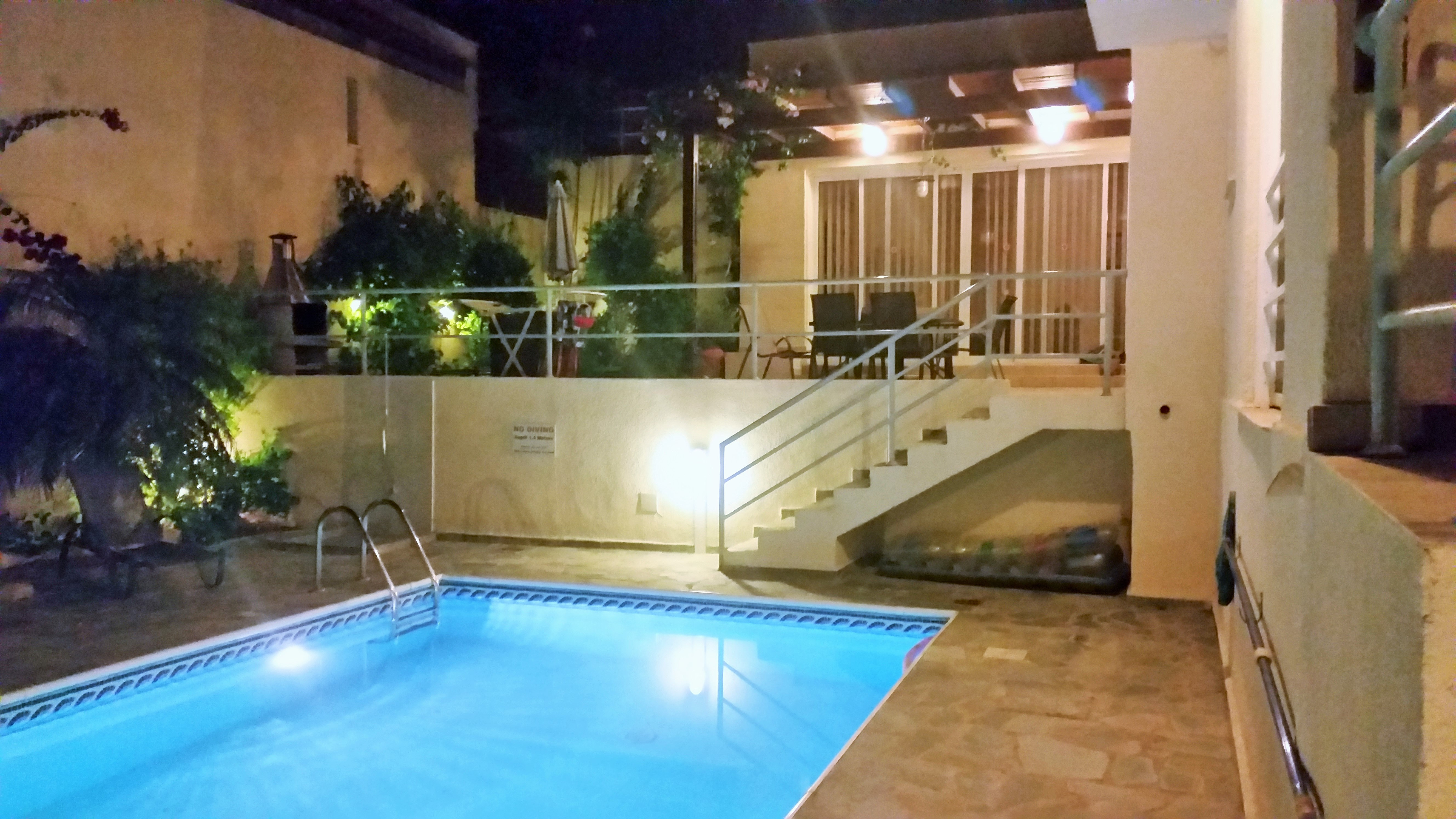 villa pheakon the pool at night. Black Bedroom Furniture Sets. Home Design Ideas
