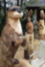 Fear na Coillte Chainsaw Scuptures.  Commissioned carving of Irish Wildlife.  Otter, Hare & owls.