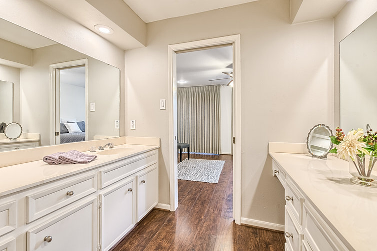 master bath with double vanity sinks ample cabinet space for storage separate toilet tubshower room huge closet entry beyond ample shower room