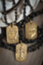 gold vermeil dog tag charms (crown, sacred heart, cross, fleur de lis) long necklace.  black lava and crystal beads