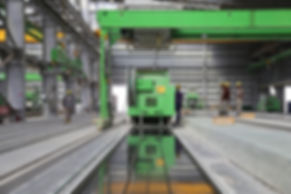 people-stands-near-green-metal-industria