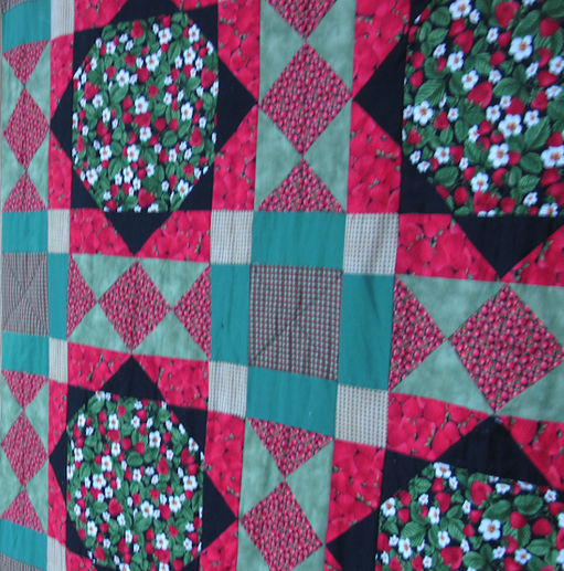 Red quilt made by Mandy